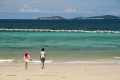 Walking along the beach. Two girls walking along the beach Stock Photo