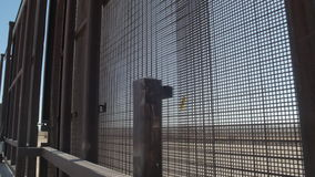 Walking Along the Border Fence on the US and Mexico Border stock video