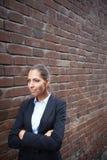 Walking along brick wall Stock Images