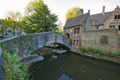 Walking along Brugge Channels Royalty Free Stock Image