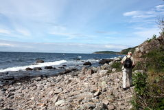 Walking along the coast Stock Image