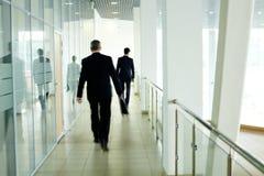 Walking along corridor Stock Photos