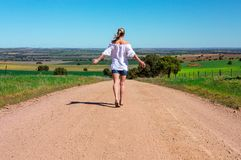 Walking along dusty country roads stock photography