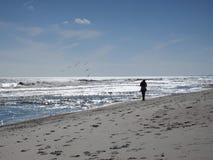 Walking Along Florida Beach. Atlantic Ocean side of Amelia Island Florida stock image