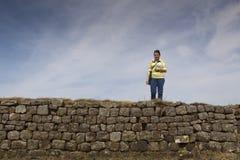 Walking Along Hadrians Wall. Woman walking along Hadrians Wall Royalty Free Stock Photo