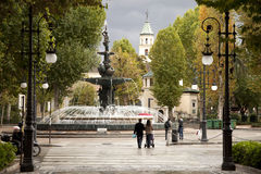 Walking along the main Pomegranate fountain in Granada, Spain Royalty Free Stock Image