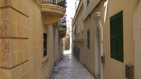 Walking along the medieval streets of Valletta, Malta. Walking along the medieval streets of Valletta, Malta stock footage