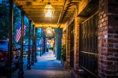 Evening walk along Front Street in Natchitoches Louisiana. Walking along the old shops and businesses on Front Street in Natchitoches Royalty Free Stock Image