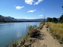 Walking along the paths of the North Thompson river in Kamloops, british columbia on a beautiful sunny fall day stock image