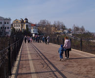 Walking along the pedestrian zone. In the warm spring weekend Stock Photos