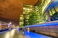 Walking along river Thames at night, London Stock Photo