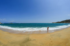 Walking along the sandy beach Royalty Free Stock Photos