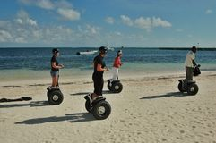 Walking along the shore of the Atlantic Ocean in Punta Cana on the Segway Human Transporter Royalty Free Stock Images