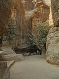Walking along the Siq gorge Stock Images