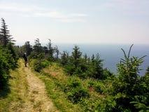 Walking along the skyline trail on Cape Breton Island, Nova Scotia, with the vast Atlantic Ocean behind stock photo