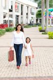 Walking along the street Royalty Free Stock Photography