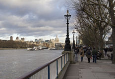 Walking along the Thames in London, UK Stock Image