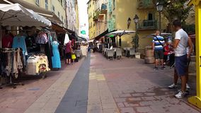 Walking Along the Typical Shopping Street in Old Menton, France stock video