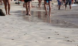 Walking on the Amadores beach, Gran Canaria, Spain Royalty Free Stock Images