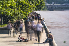 Walking amongst crowds of people along the parkway. On a warm summe day Stock Photos