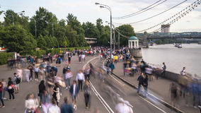 Walking amongst crowds of people along the parkway. On a warm summer day Royalty Free Stock Photography