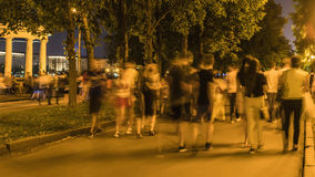 Walking amongst crowds of people along the parkway. On a warm summer day Royalty Free Stock Images