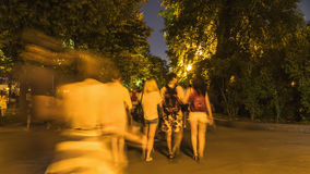 Walking amongst crowds of people along the parkway. On a warm summer day Royalty Free Stock Photo