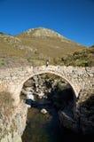 Walking on ancient bridge Stock Photo