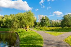 Walking area on a warm summer evening. MOSCOW, RUSSIA - 23 JULY, 2017: Walking area on a warm summer evening in a recreation area in Altufevo, Moscow Stock Image