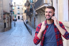 Walking around the city and making a call Stock Image