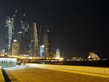 Walking around Corniche. Doha Corniche at night lightened by the street lamps Royalty Free Stock Photo