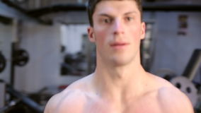 Walking Around An Exercising Man In The Gym. Athletic sport lifestyle stock video footage