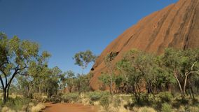 Walking around mystical Ayers Rock Uluru situated in Red Centre of Australia. Northern Territory stock photography