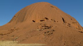 Walking around mystical Ayers Rock Uluru situated in Red Centre of Australia stock photos