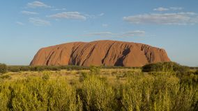 Walking around mystical Ayers Rock Uluru situated in Red Centre of Australia stock image