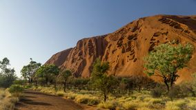 Walking around mystical Ayers Rock Uluru situated in Red Centre of Australia stock photo