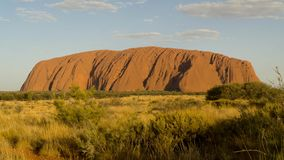 Walking around mystical Ayers Rock Uluru situated in Red Centre of Australia. Northern Territory stock image