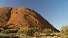 Walking around mystical Ayers Rock Uluru situated in Red Centre of Australia royalty free stock photography