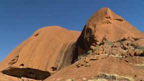 Walking around mystical Ayers Rock Uluru situated in Red Centre of Australia royalty free stock photos