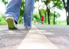 Walking on asphalt path Royalty Free Stock Images