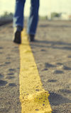 Walking on asphalt road. Royalty Free Stock Image