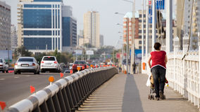 Walking in Astana. An European woman walking in Astana Royalty Free Stock Photos