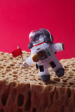 Walking astronaut, red background. Light bulb character dressed in spacesuit and spaceman ammunition. Cosmonaut with. Walking astronaut, red planet Mars Stock Photos