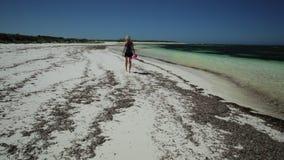 Walking on Australia Beach. Beach fun summer vacation. Joyful happy woman walking on the seashore of pristine and white sand in Hangover Bay, Nambung National stock video footage