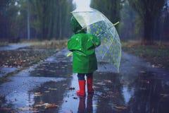 Walking in autumn rainy park