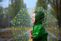 Walking in autumn rainy park Stock Photos