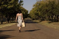 Walking away brunette Stock Photo
