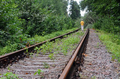 Walking Away Down Abandoned Railroad Track Royalty Free Stock Photo