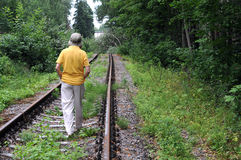 Walking Away Down Railroad Track Royalty Free Stock Photography
