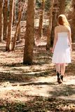 Walking away. Woman in a forest walking away Royalty Free Stock Image